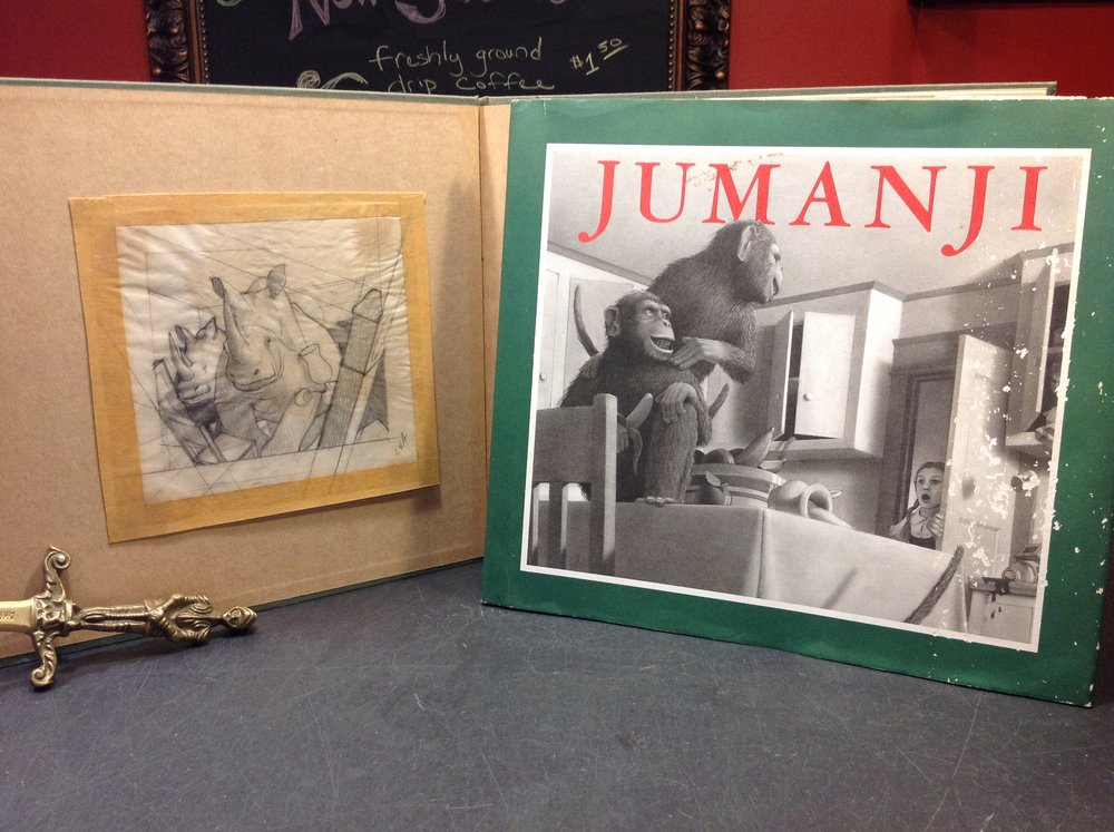 Jumanji by Chris van Allsburg - 1981, First Edition, Houghton Mifflin. Signed with illustration. Also contains tipped-in original, signed artwork by Allsburg of two rhinos entering a room.