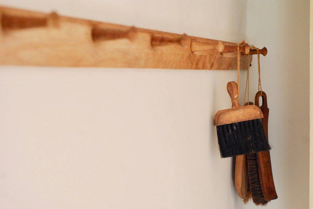 Handmade wooden peg rail