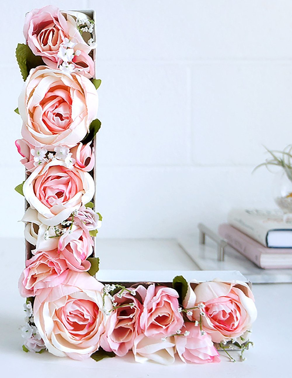 """Photo Credit:  CountyLiving.com   Flower filled letters is a very romantic way to say  """" I love you""""  as well as save some cash. Again, get the realistic roses not the real ones to save lots of money!"""