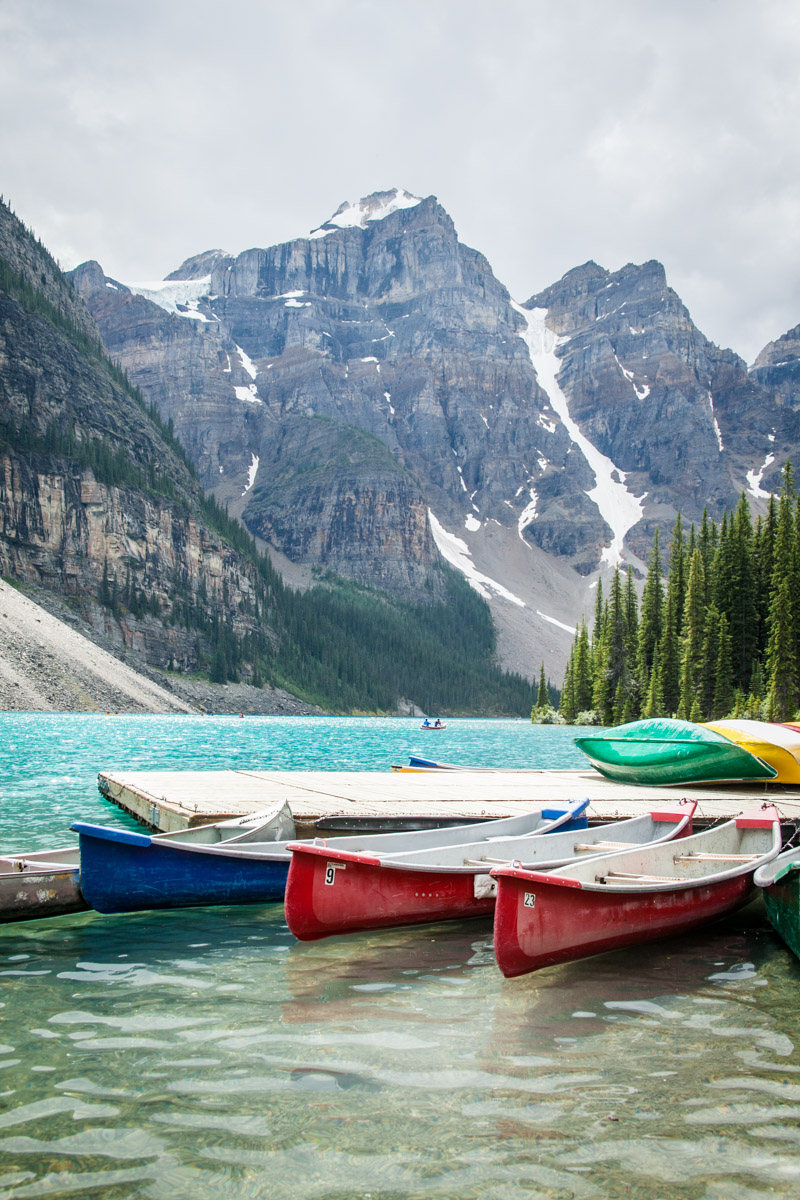 Alaska mountains in the background of the beautiful lake with colorful canoes