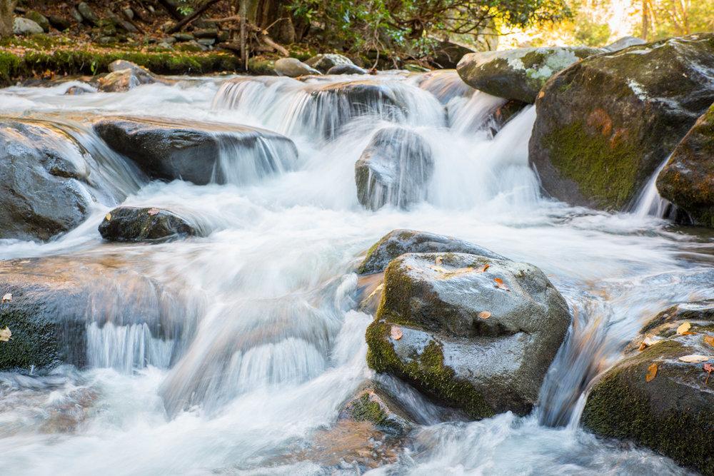 Waters rushing over rocks