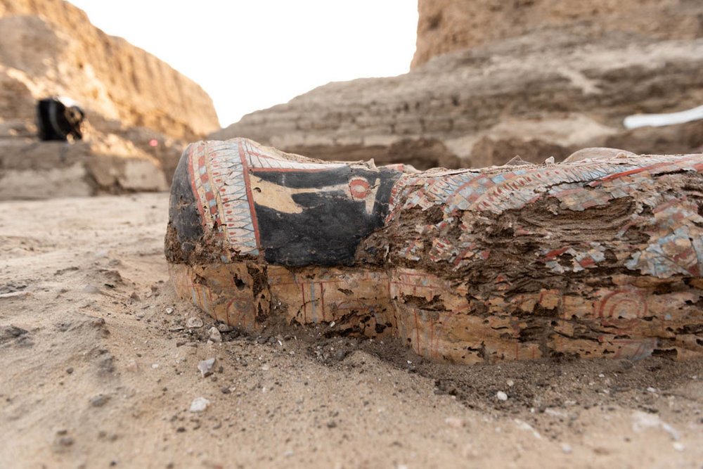 Fig. 1. Painted, anthropoid coffin in situ, outside the east corner gateway of the Shunet el-Zebib. Photo: Ayman Damarany / North Abydos Expedition © 2019
