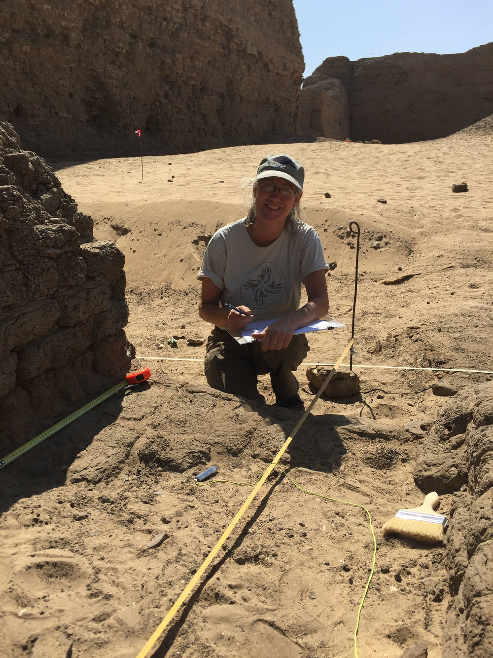 Fig. 5. Archaeologist Kay Barnett mapping the east corner gateway of the Shunet el-Zebib. Photo: Wendy Doyon / North Abydos Expedition © 2019