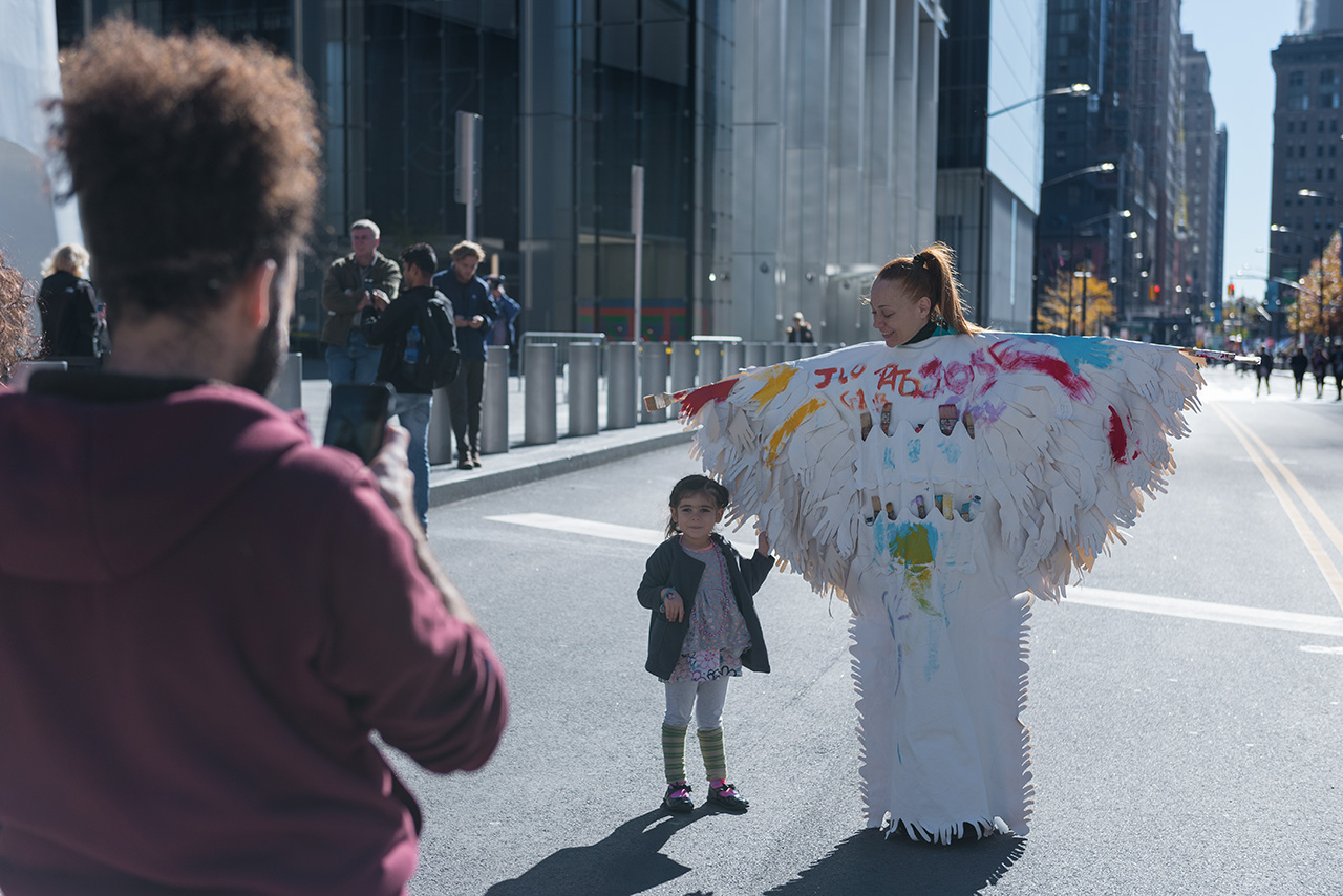 Memory Replacement Roaming Installation and Performance with Public Participation at the World Trade Center Memorial site by New York city based artist Mirena Rhee