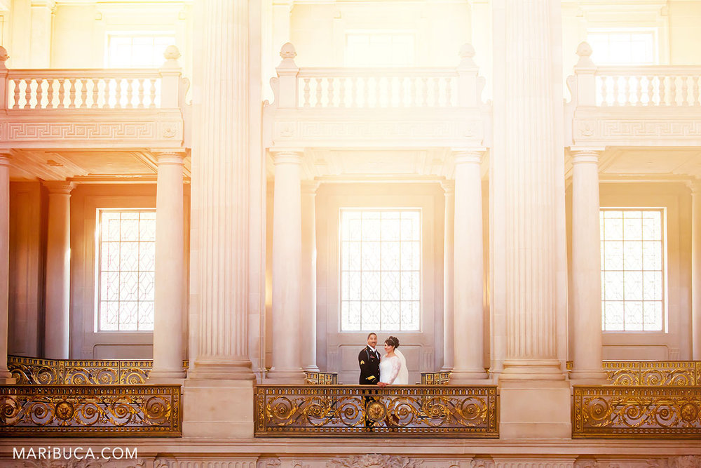 San francisco city hall wedding where the bride and the groom are staying in the an amazing yellow-orange rays light in the early morning.