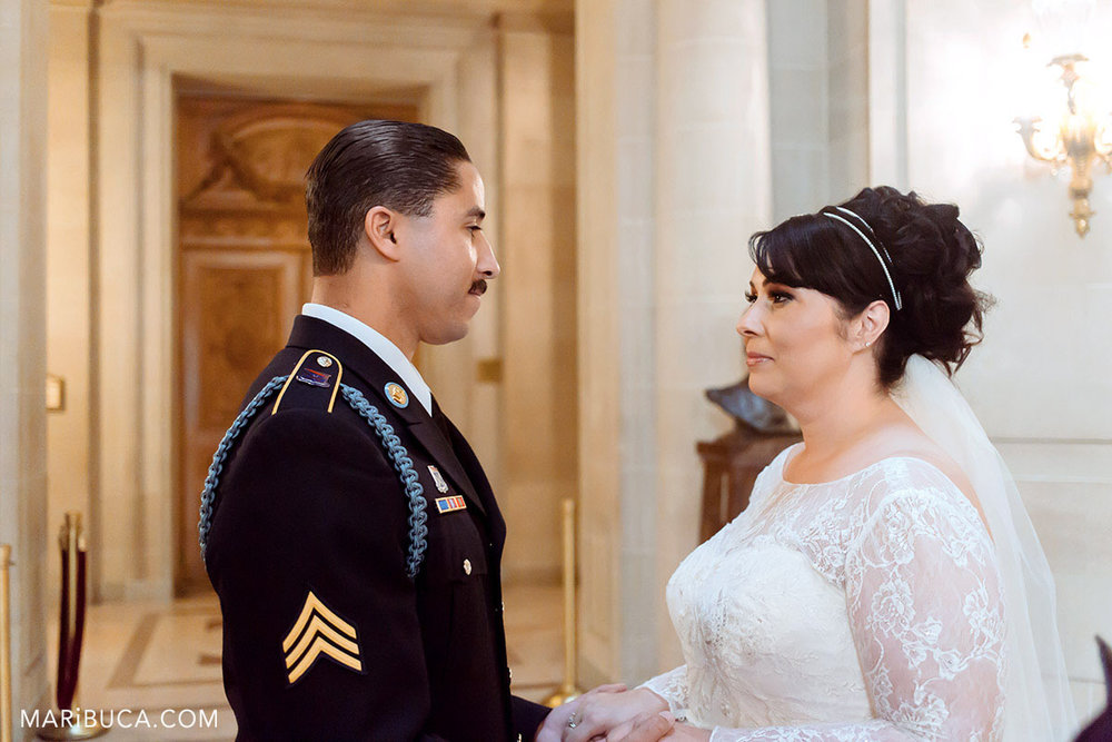 the groom and the bride look each other in the ceremony SF CIty Hall