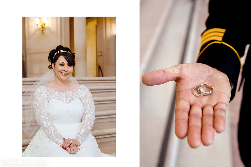 the bride in the white dress is sitting in the staircases, groom's hand shows two wedding rings