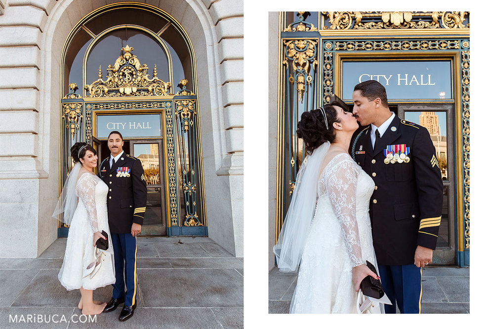 """Newlyweds enjoy each other outside of the San Francisco City hall and the sign in the background of the window """"City Hall"""" California."""