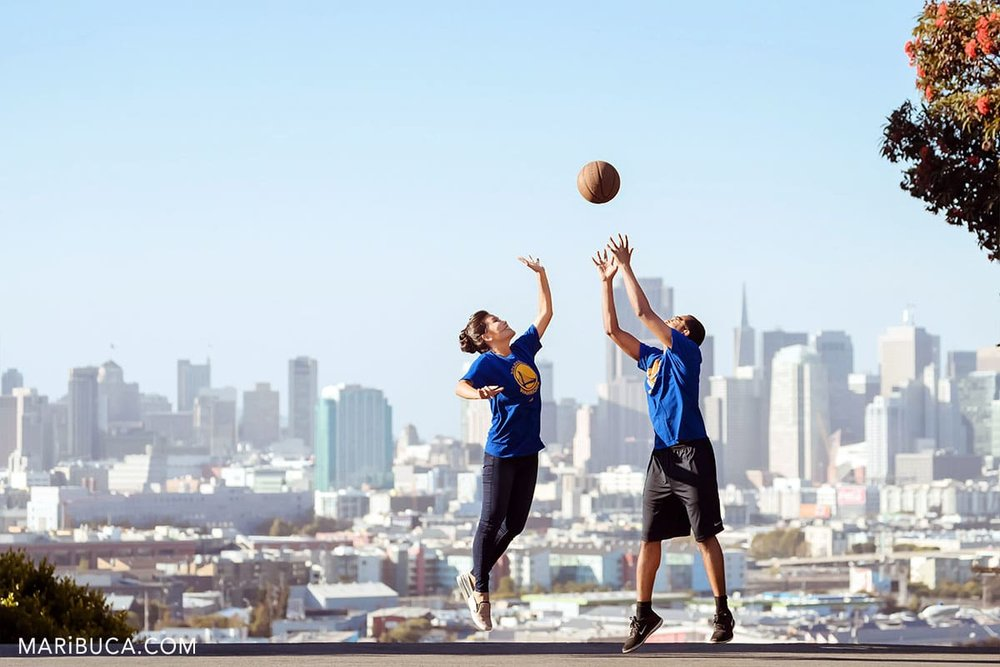 amazing view in the San Francisco with adorable couple playing the basketball