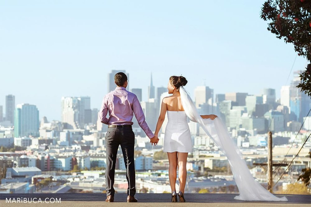 couple looking in the Financial district in the San Francisco. Looks like wedding day but this is engagement photo.