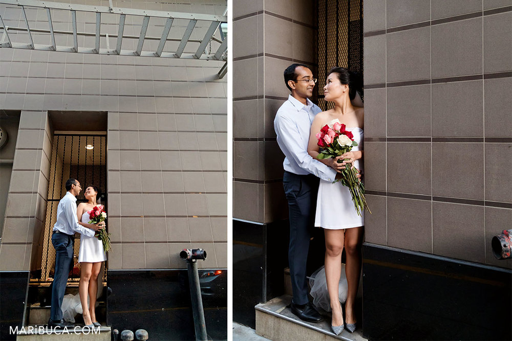 downtown San Francisco. fiancee and fiance look each other. They wearing blue shorts and white engagment dress.