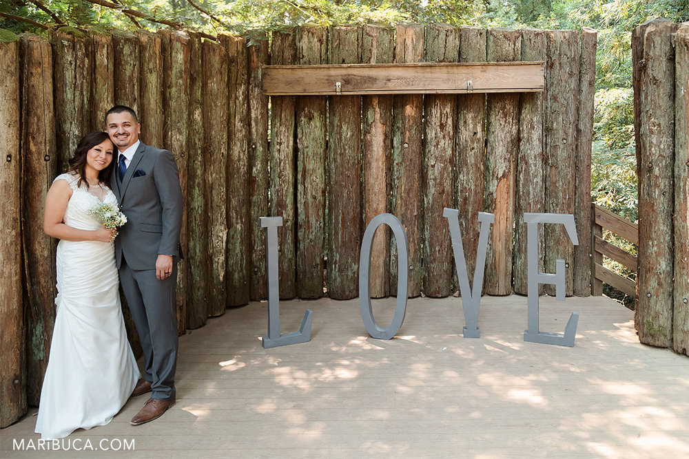 Love sing as the background and married couple after ceremony in the Watsonville