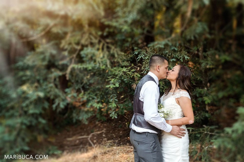 Couple without guests kissing each other in the Mt Madonna County Park