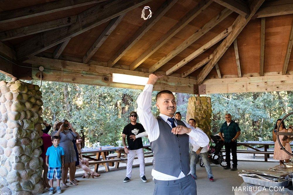 the groom throws the garter to groomsmen