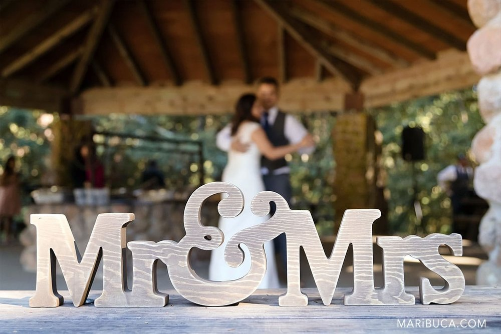 First wedding dance from newlyweds and the big wooden sign mr&mrs