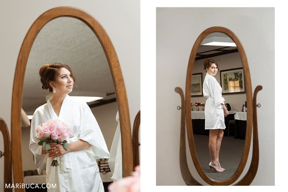 the bride getting ready and look in the mirror in the wente vineyards estate winery.