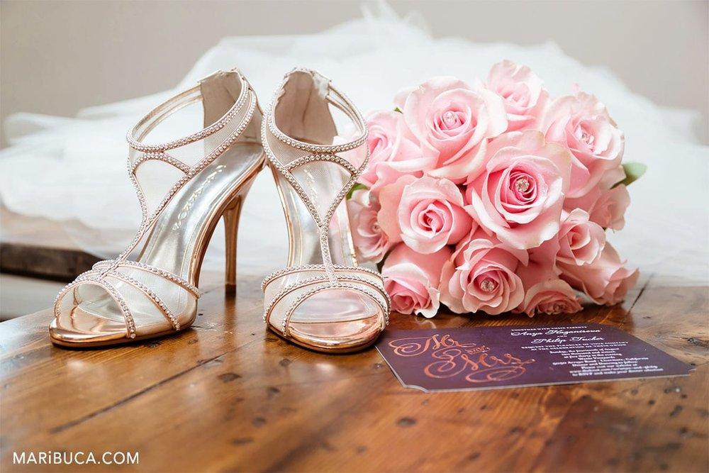 Wedding preparation: wedding shoes, wedding bouquet and wedding invitation