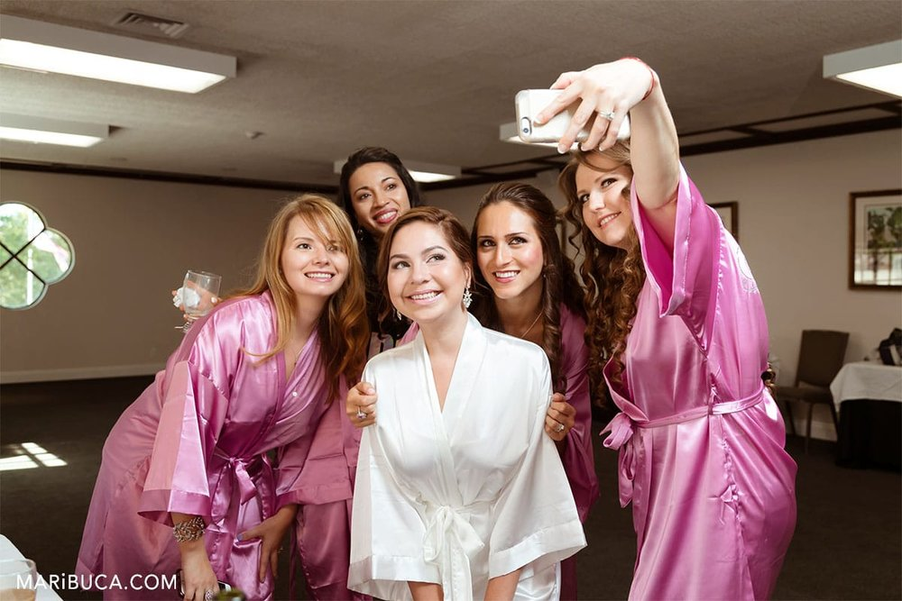 Bridesmaids and the bride create a selfie in the Wente Vineyards