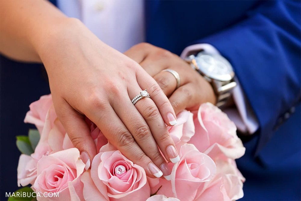 Wedding details. Newlyweds show the wedding rings.
