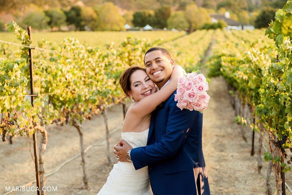 Lovely bride and groom in the Wente Vineyards; Livermore, CA
