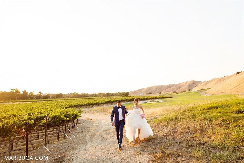 Bride and groom run to reception.