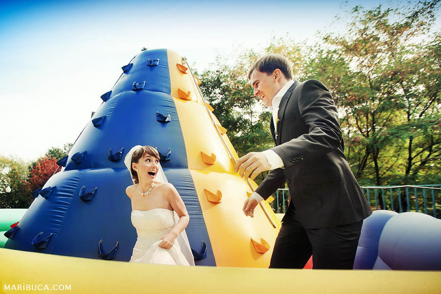 bride and groom at an amusement park on their wedding day