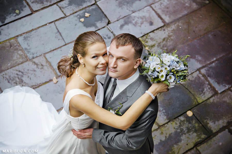 Bride and groom look up in the Rancho San Antonio Wedding, California