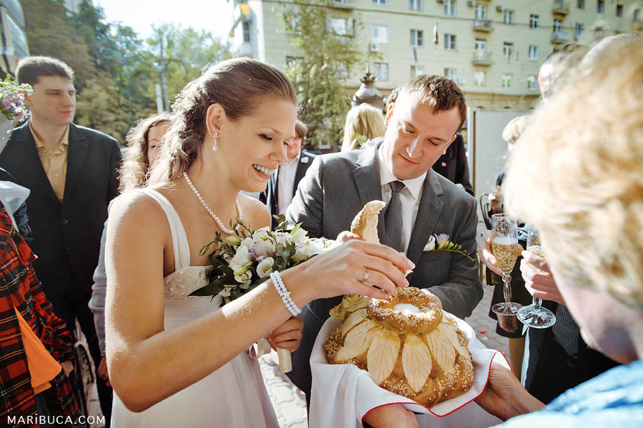 Russian tradition when bride and groom use salt for the piece of bread and after feed each other.