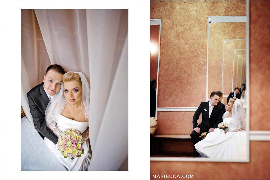 Bride and groom spend time together before the wedding ceremony in the register office.