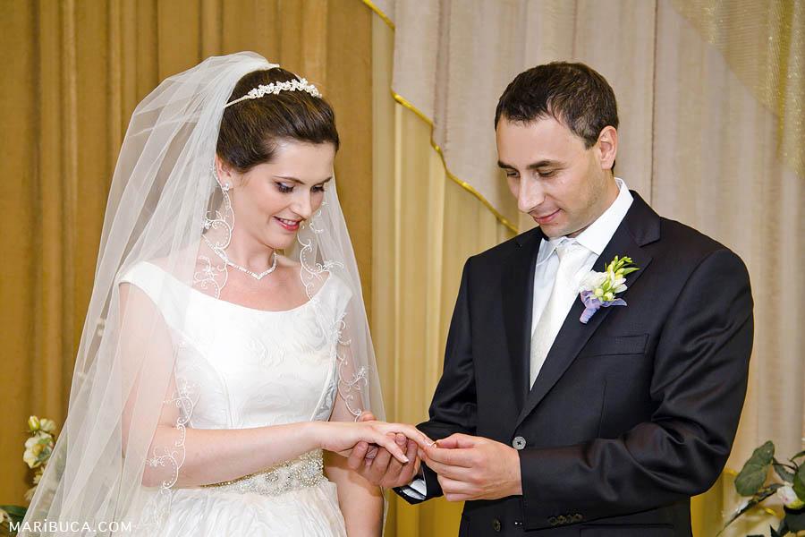 bride and groom in registry office exchanging wedding rings