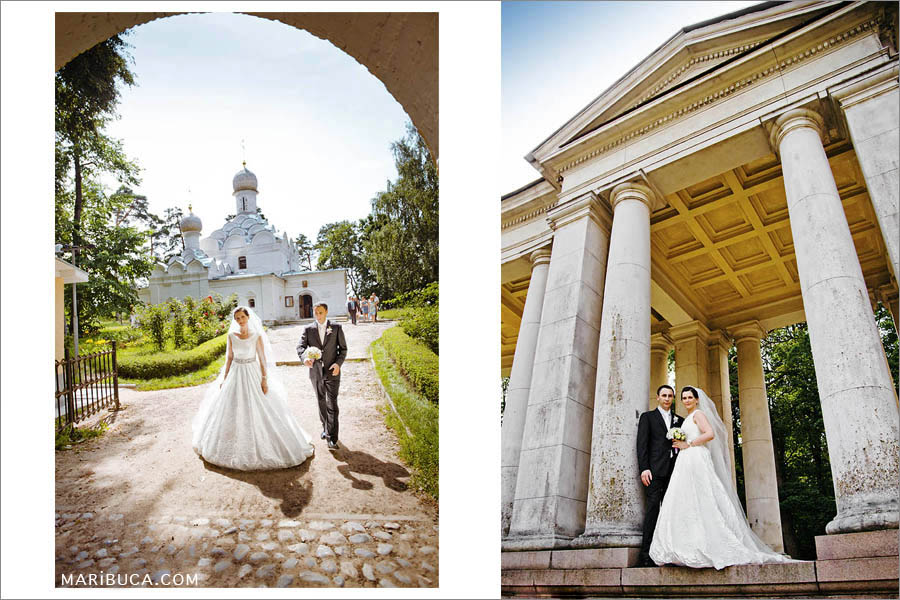 the bridegroom in a black suit and white tie, the bride in a long luxurious dress against the background of a white Christian church and among the columns with history.