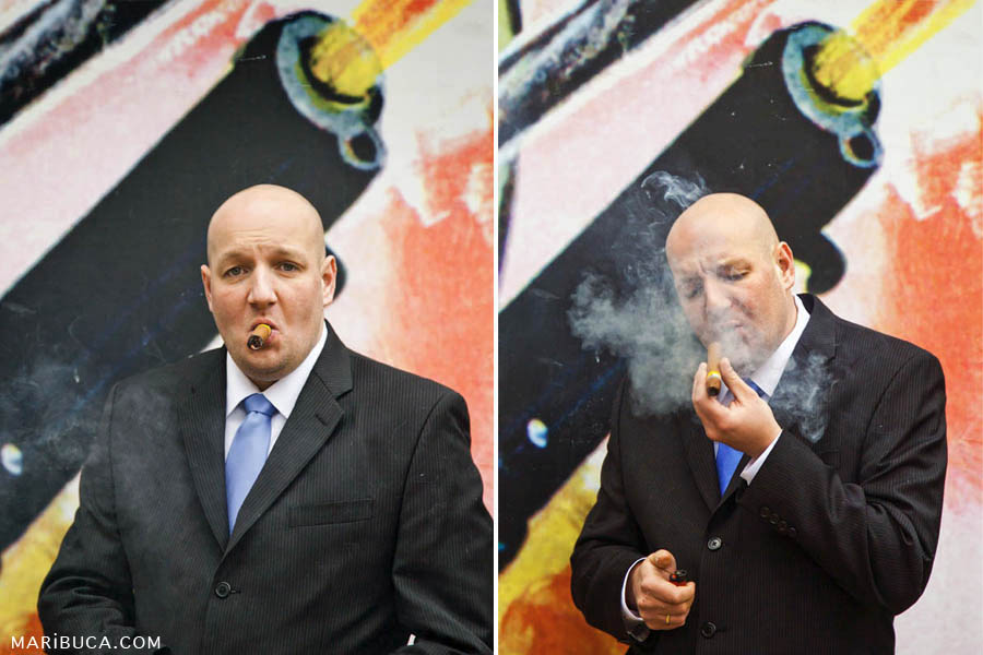 The groom is smoking a cigar and blows smoke portraying a gangster style in the background Street art picture with a gun slinger.