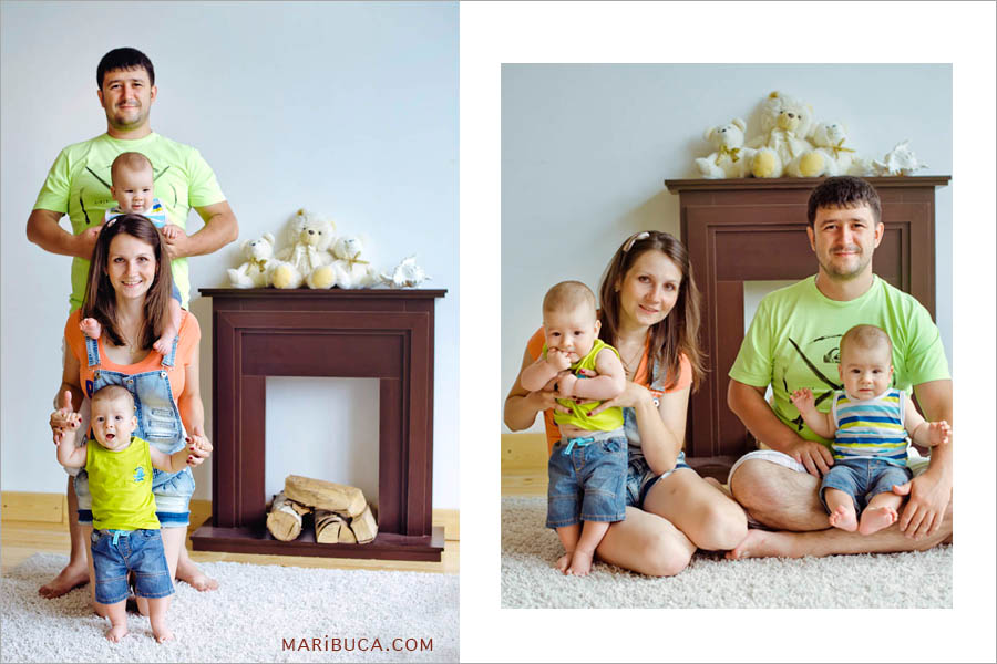 photo of a family of four: mom, dad and 8 month old sons of twins against the background of a fireplace and a white wall.