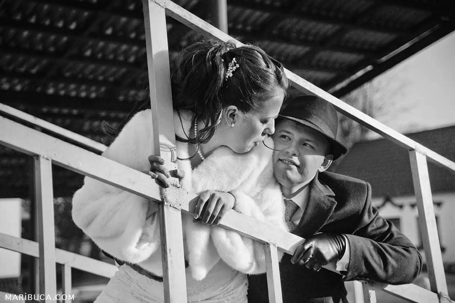 black and white photo of the bride and groom look at each other.