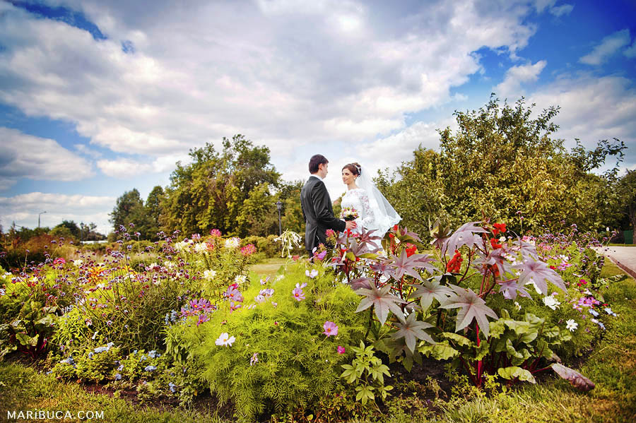 Bride and groom as christian couple loves to take pictures outdoor before their ceremony.