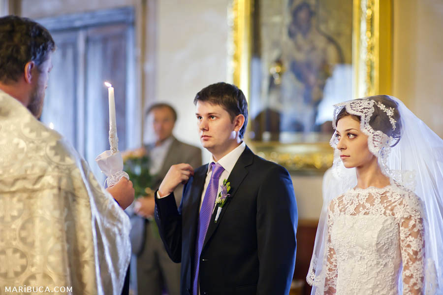 Orthodox christian wedding ceremony with bride and groom