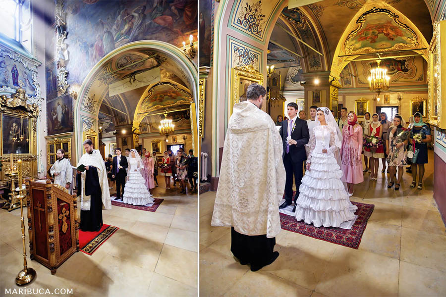 wedding ceremony in a christian orthodox church and rays of white rays from the window