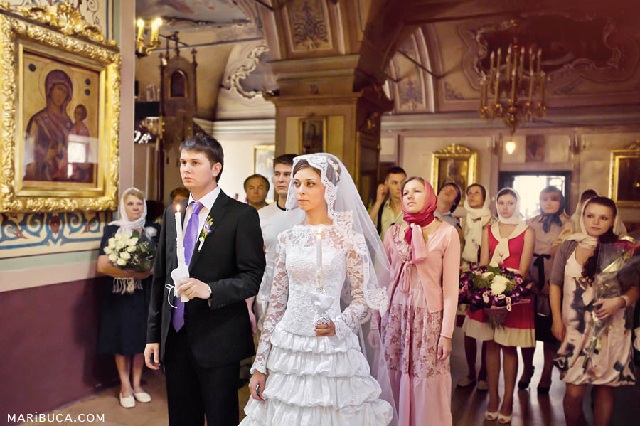 bride and groom with guests at a wedding ceremony in a christian church