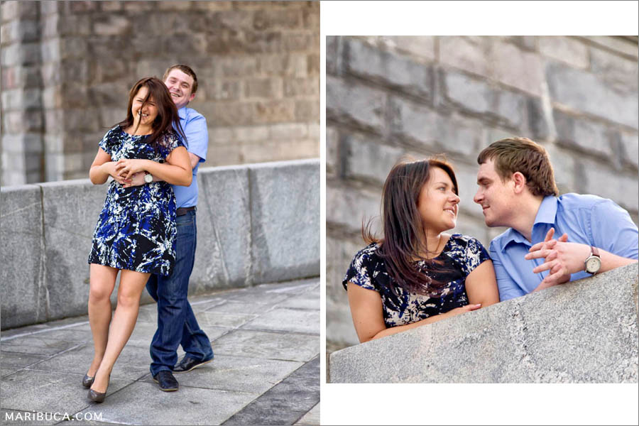 Couple looks each other and fool around in their engagement day