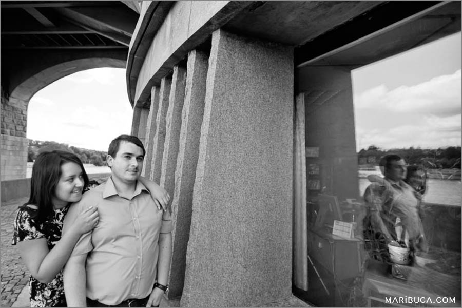 Reflection of couple through window under the bridge