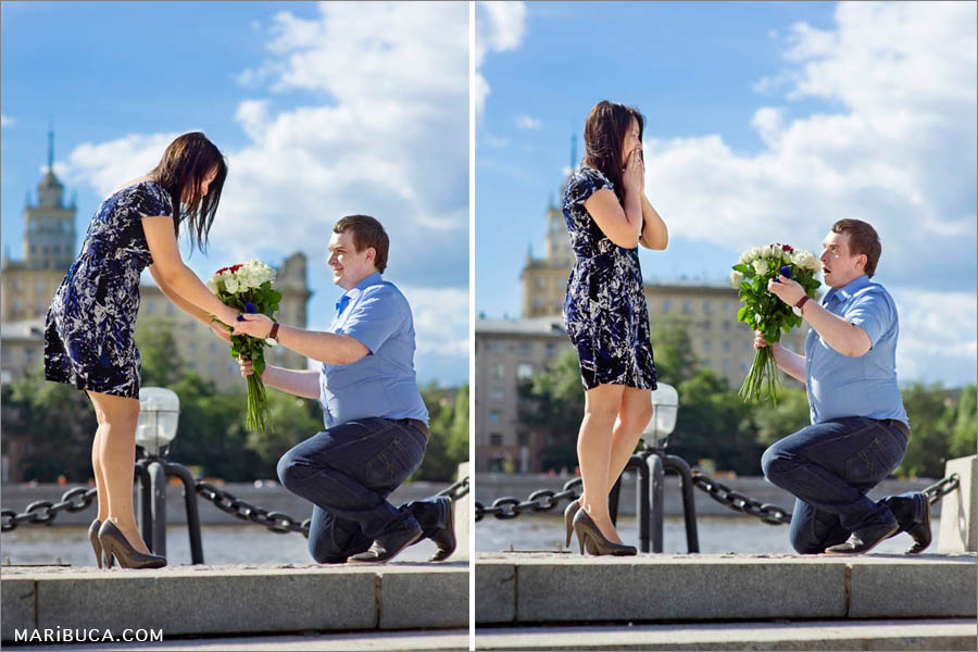 The guy proposing and stays in the one knee for proposing his future wife. She so excited and happy.