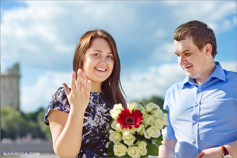 The lady shows engagement ring in her finger during engagement.