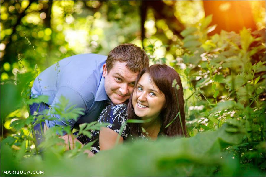 The guy and girl hiding among the high grass in the garden, Palo Alto