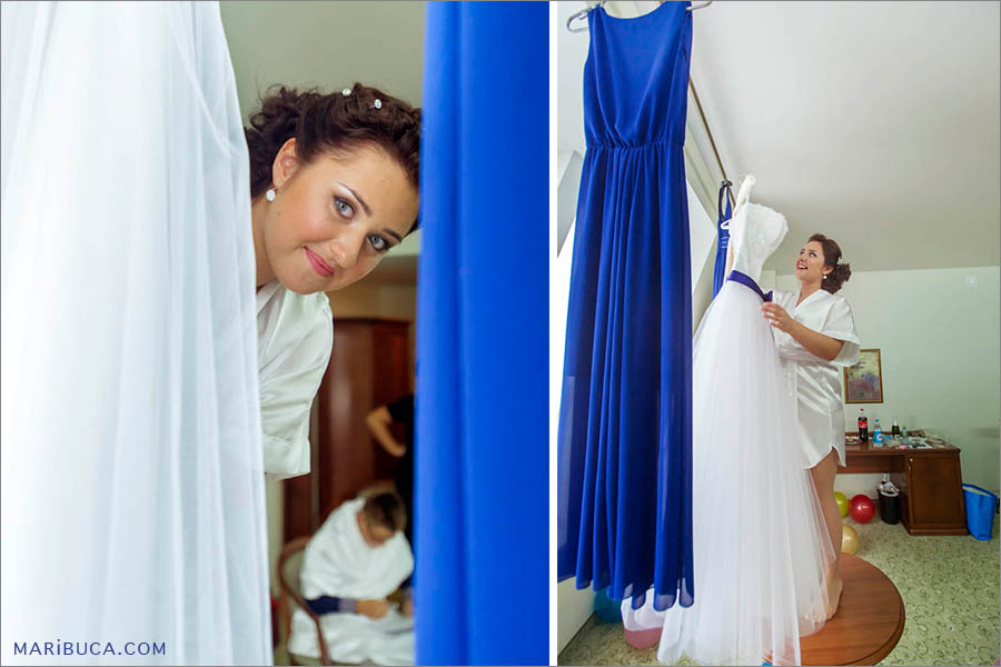 The bride looks next to her wedding dress. The bride takes off her wedding dress in the Hilton, Santa Clara