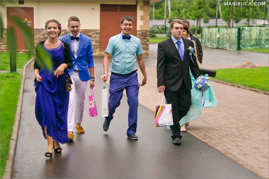 The groom and bridal party arrived in the hotel to see the bride and friend.
