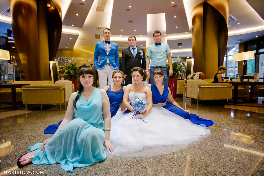 Group picture of the bridal party, bride and groom in the amazing hotel, Hilton.