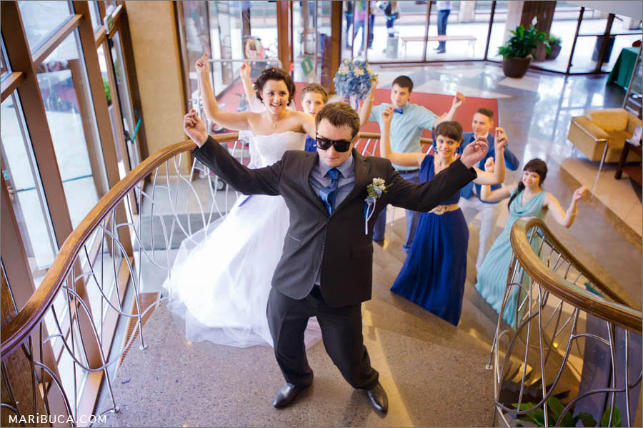 The groom and bride are dancing with wedding party in the Villa Ragusa restaurant, Campbell.