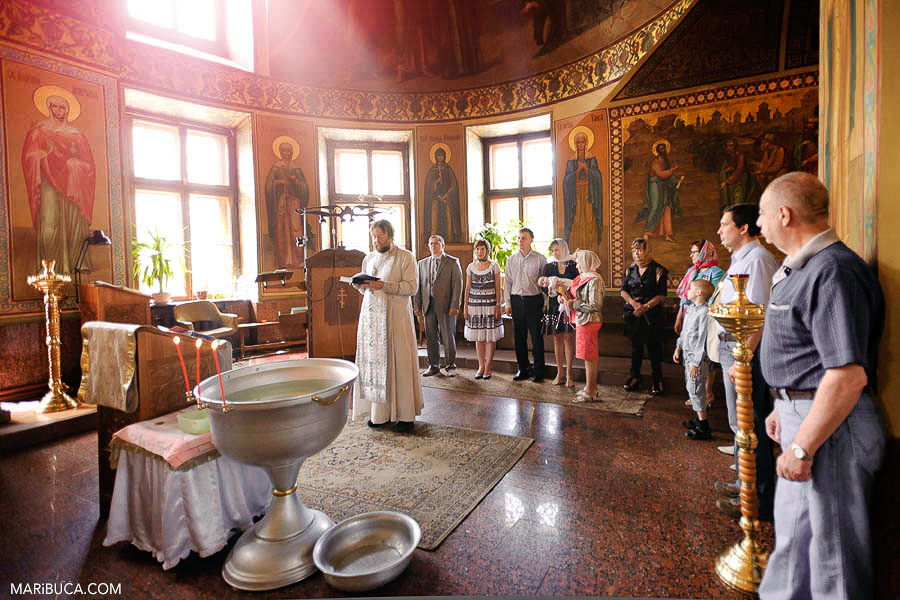 San Francisco Orthodox church during christening and all family together.