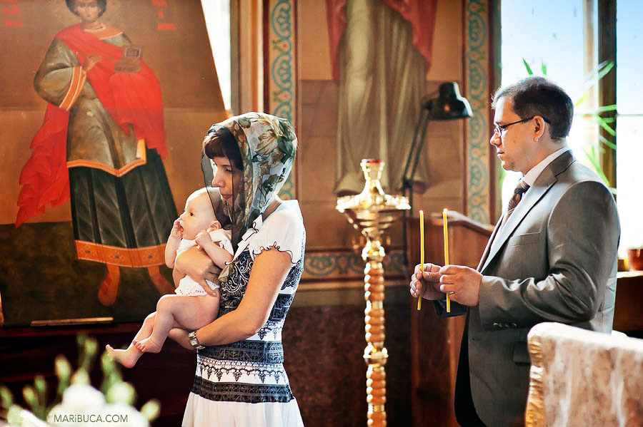 One of the tradition of the orthodox christening when godparents go three times go around the font as a sign of spiritual joy of uniting with Christ for eternal life in the Kingdom of Heaven.