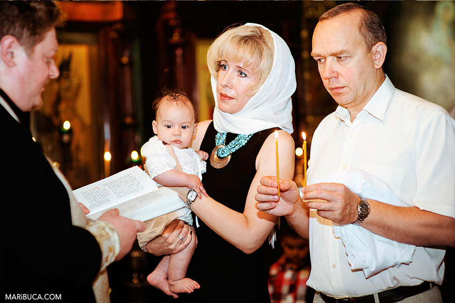church-moment-godfather-holds-candles